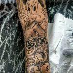 tatuagem tio patinhas no braço